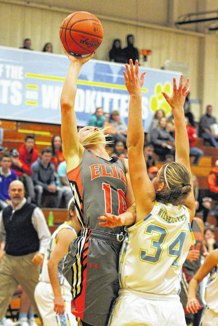 Elida's Hayleigh Bacome puts up a shot against Bath's Madelyn Renner during the championship game of the the 14th annual Kewpee Tip-off Classic at Bath High School.