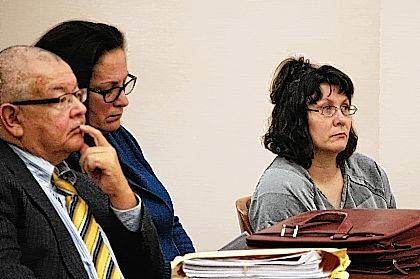 Crystal Kindle, right, is pictured with her defense attorneys Joe Benavidez and Linda Gabriel during a court hearing Thursday. Kindle was ruled competent to stand trial on a variety of charges related to human trafficking and the illegal use of a minor in nudity-oriented material or performance.