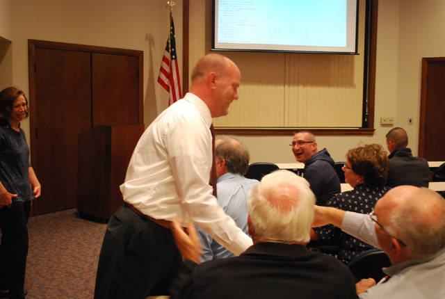 Andrew Augsburger accepts congratulations at the Auglaize County Board of Elections on Tuesday evening after his convincing win in the race for judge of the county municipal court.