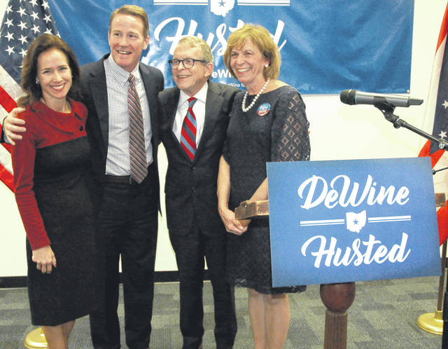 Attorney General Mike DeWine (center right) and Secretary of State Jon Husted (center left) announced they are joining forces for the 2018 Ohio governor election. They are pictured with their spouses Fran DeWine (right) and Tina Husted (left).