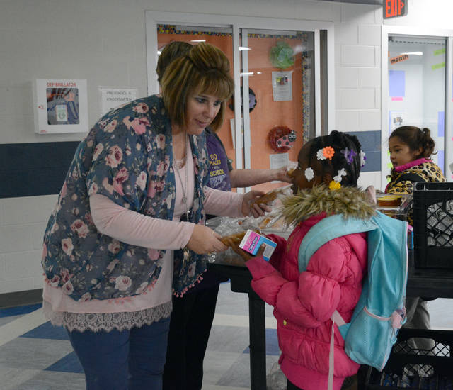 Carrie Woodruff is seen interacting with a student .