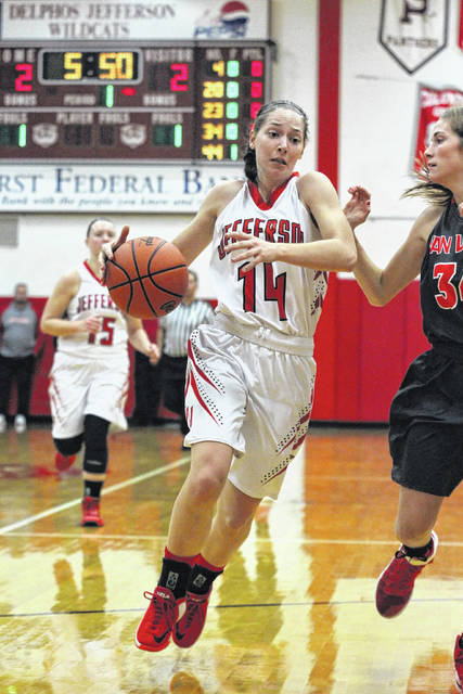 Delphos Jefferson's Devyn Carder drives to the basket during Thursday night's game against Van Wert in Delphos. See more game photos at LimaScores.com.