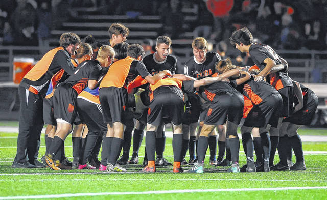 Elida huddle before playing Bay in Saturday night's Division II regional final at Mansfield Madison. See more match photos at LimaScores.com. Richard Parrish | The Lima News