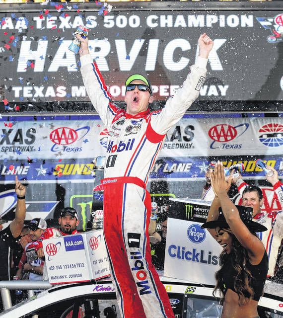 Kevin Harvick celebrates in Victory Lane after winning the NASCAR Cup Series auto race at Texas Motor Speedway in Fort Worth, Texas, Sunday, Nov. 5, 2017. (AP Photo/LM Otero)