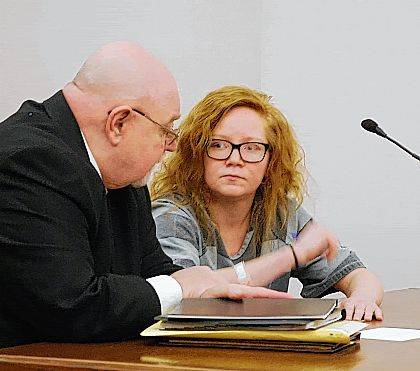Karly Wolfrey confers with her attorney, Greg Donohue, during a change-of-plea hearing Thursday in Allen County Common Pleas Court.