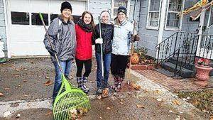 Leos rake leaves in Columbus Grove