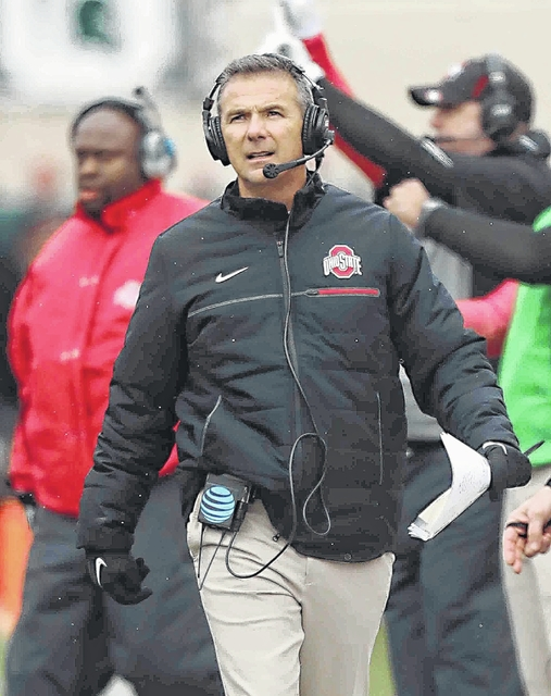 Ohio State coach Urban Meyer talks with coaches in the press box during a 2016 game at Michigan State.