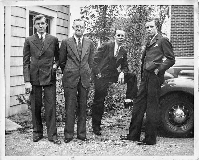 Myrle, Nicholas J., Nicholas P. and Robert L. Hogenkamp pose for a photo. The year is unknown. Nicholas J. was the father of the other men pictured.