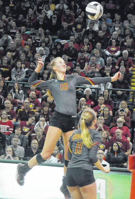 New Bremen's Paige Jones goes up for a spike during Saturday's Division IV state championship match against St. Thomas Aquinas at Wright State's Nutter Center.