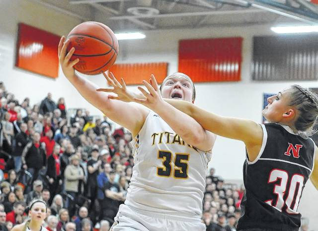 Ottawa-Glandorf's Kadie Hempfling puts up a shot against Norton's Jimi Howell during the Division II regional final last year. The Titans hope to make another trip to state behind the Bowling Green-bound Hempfling, but a move down to Division III could challenge the Titans.
