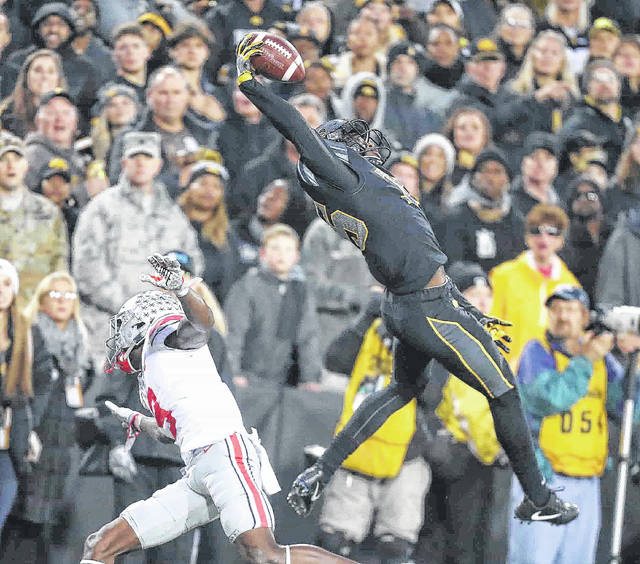 Iowa's Josh Jackson makes a one-handed interception during Saturday's game against Ohio State in Iowa City, Iowa.
