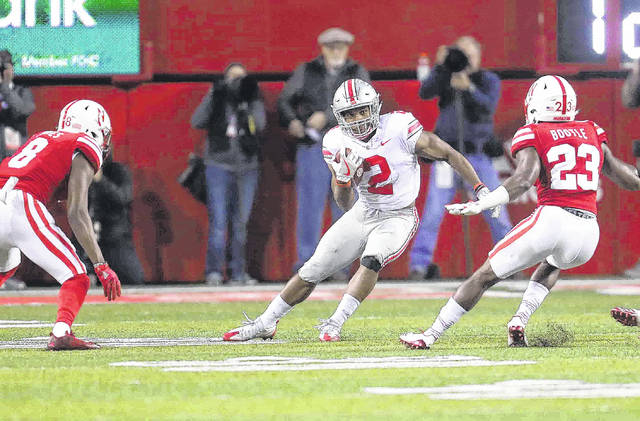Ohio State's running back J.K. Dobbins looks to get past Nebraska's Chris Jones (8) and Dicaprio Bootle during a game last month at Memorial Stadium in Lincoln, Neb.