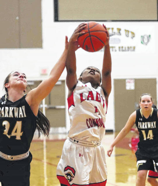 Perry's Trinity Gurley pulls down a rebound against Parkway's Leah Harshman during Thursday night's game at Perry High School.
