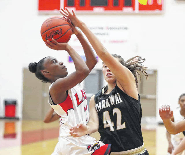 Perry's Tia Barfield puts up a shot against Parkway's Claire Eichler during Thursday night's game at Perry High School. See more game photos at LimaScores.com.