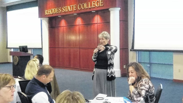 Rhodes State College Vice President of Student Affairs Rose Reinhart addresses area school superintendents, principals and guidance counselors during an informational session on the College Credit Plus progam Thursday at Rhodes State College.