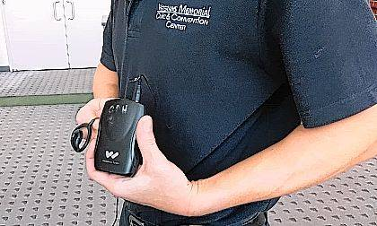 John Garner of Veterans Memorial Civic and Convention Center holds a Williams Sound receiver, part of a new system to aid those with hearing difficulties in enjoying events in Crouse Performance Hall.