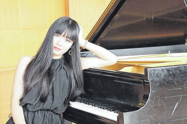 Yaoyue Huang will be the guest artist for the symphony's concert this weekend.
