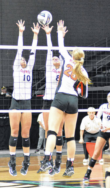 Coldwater's Taylor Siefring (10) and Allison Sudhoff (8) go up for a block against Versailles' Elizabeth Ording during Saturday's Division III championship match at Wright State's Nutter Center.