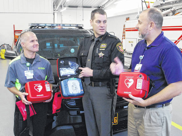Allen County Sheriff Matt Treglia, center, on Thursday accepted the donation of four defibrillators from representatives of Lima Memorial Hospital and Mercy Health-St. Rita's. Doug LaRue, left, and Brian Anderson, EMS coordinators at Lima Memorial and Mercy Health, respectively, presented the life-saving machines to the sheriff.