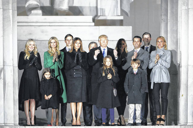 """FILE - In this Jan. 19, 2017, file photo, then-President-elect Donald Trump and his wife Melania Trump and family wave at the conclusion of the pre-Inaugural """"Make America Great Again! Welcome Celebration"""" at the Lincoln Memorial in Washington. Four years ago, well before the furor over allegations Moscow engaged in cybermeddling to help get Donald Trump elected, at least 195 web addresses belonging to Trump, his family or his business empire were hijacked by hackers who may have been operating out of Russia, The Associated Press has learned. The Trump Organization denied the domain names were ever compromised. But it was not until this week — after the Trump camp was asked about it by the AP — that the last of the tampered-with addresses were repaired."""