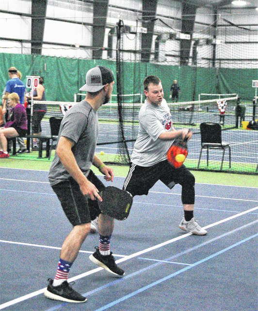 Tyler Cornwall (left) and Corbin Ellison (right), both from Lima, teamed up to participate in the 2017 Fall Classic Pickleball tournament at the Westwood Tennis and Fitness Center over the weekend.