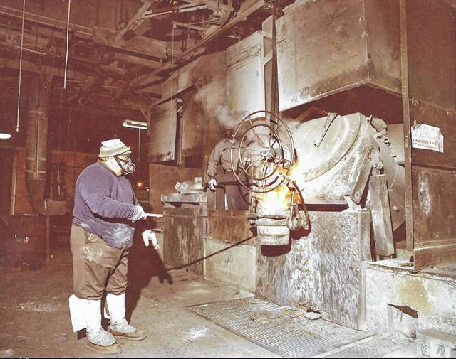 A worker pours metal at the plant in the 1970s.