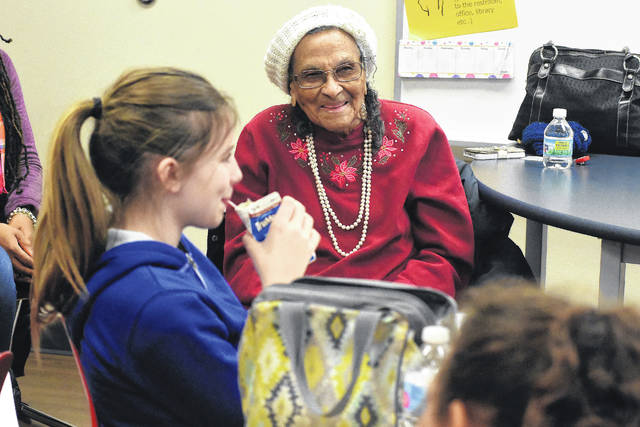 Thelma Wilson, 101, of Lima, talks to sixth-grade girls at Perry Elementary School on Thursday afternoon.