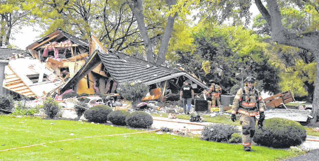 Firefighters work to rescue homeowner, Jim Mauk, after being trapped in his home at 4230 Slabtown Road in Bath Township after the home exploded in October. Fran Mauk, his wife was also rescued from the home. Craig J. Orosz | The Lima News