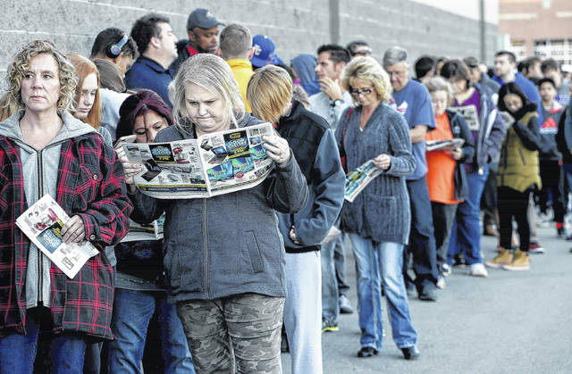 People wait in line for a Best Buy store to open for a Black Friday sale on Thanksgiving Day this year in Overland Park, Kan. On average, Americans plan to spend more than $550 on gifts for friends and loved ones this holiday season, according to a recent NerdWallet survey conducted by Harris Poll. But budgets are tight.