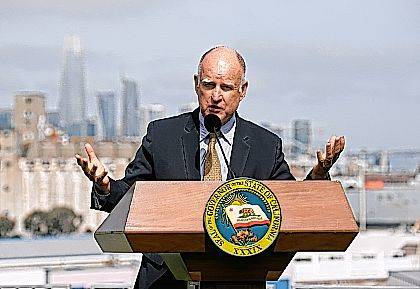 FILE - In this Sept. 29, 2017, file photo, California Gov. Jerry Brown gestures while speaking in San Francisco. The AP reported on Dec. 1, 2017, that a story claiming Brown signed a law that allows HIV-positive people to donate blood is false. Brown did approve a law in October that lessens criminal penalties for knowingly infecting another person with HIV, but it doesn't allow those with the virus that causes AIDS to donate blood. (AP Photo/Eric Risberg, File)