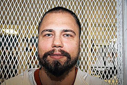 This Oct. 1, 2017 photo shows inmate Clinton Young, outside death row at the Polunsky Unit prison near Livingston, Texas. Young was among more than three dozen inmates, one-third of them from Ohio, who avoided scheduled trips to the death chamber this year after winning reprieves from courts. A court reprieve that halted the scheduled December lethal injection of another Texas prisoner means 2017 will end with 23 inmates executed in the U.S, a slight rise from a year ago, and Texas regaining its standing as the nation's most active state in carrying out capital punishment. (AP Photo/Mike Graczyk)