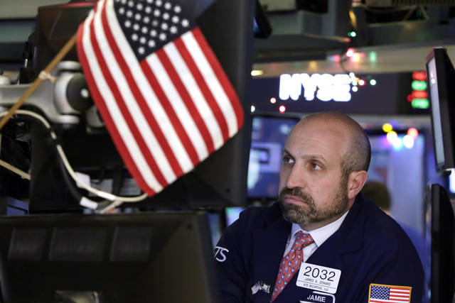 Specialist James Denaro works at his post on the floor of the New York Stock Exchange, Monday, Dec. 4, 2017. Stocks rose Monday on expectations that lower taxes will help corporate profits pile up even higher. (AP Photo/Richard Drew)