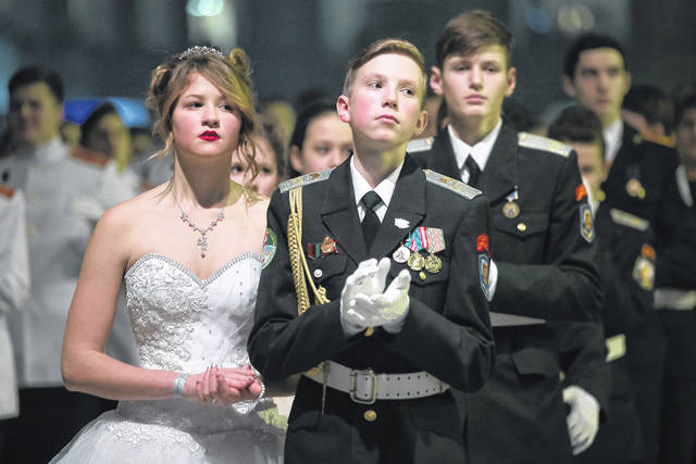 Military school students wait to dance during their annual ball in Moscow, Russia, on Tuesday. The ball attracts youth from all over Russia.