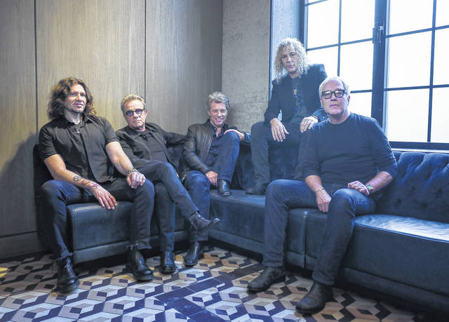 Members of Bon Jovi, from left, Phil X, Tico Torres, Jon Bon Jovi, David Bryan and Hugh McDonald pose for a portrait in 2016. The band will be inducted into the Rock and Roll Hall of Fame on April 14 in Cleveland.