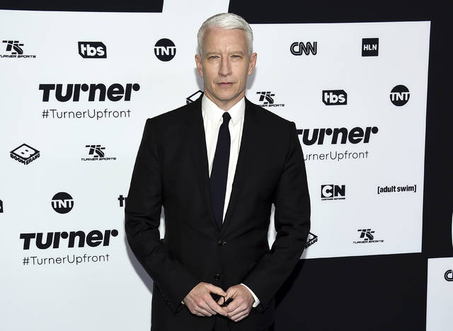 "FILE - In this May 17, 2017, file photo, CNN News anchor Anderson Cooper attends the Turner Network 2017 Upfront presentation at The Theater at Madison Square Garden in New York. CNN is claiming Wednesday, Dec. 13, that Cooper's Twitter account was hacked after a tweet from his handle called the president a ""pathetic loser"" following Democrat Doug Jones winning Alabama's special Senate election. (Photo by Evan Agostini/Invision/AP, File)"