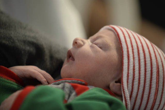 In this Monday, Dec. 25, 2017 photo, Hannah Lindeman holds her newborn daughter, Poppy, at United Hospital in St. Paul, Minn. Husband, Taylor Lindeman delivered their baby on the side of a frigid road while they were rushing to the hospital on Christmas Day. (Aaron Lavinsky/Star Tribune via AP)