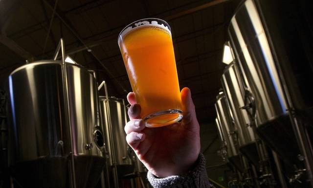 FILE - This Dec. 11, 2013, file photo, shows a beer at a microbrewery in Birmingham, Ala. Craft breweries are raising a glass to the Republicans' new tax overhaul: It cuts the excise tax on beer. (AP Photo/Dave Martin, File)