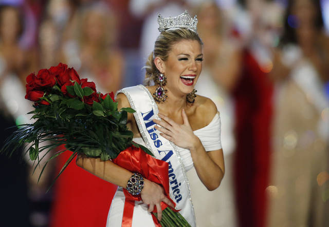 In this Jan. 12, 2013 file photo, Miss New York Mallory Hytes Hagan reacts as she is crowned Miss America 2013 in Las Vegas. Trashed by emails sent by pageant officials, former Miss Americas will help choose the new leaders of the Miss America Organization. Hagan's sexual habits were mocked in the emails.