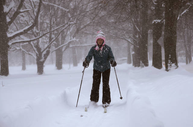 Jael Lippert cross country skis Friday in Erie, Pa. The cold weather pattern was expected to continue through the holiday weekend and likely longer, according to the National Weather Service, prolonging a stretch of brutal weather blamed for several deaths, crashes and fires.