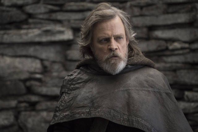 """FILE - This file image released by Lucasfilm shows Mark Hamill as Luke Skywalker in """"Star Wars: The Last Jedi."""" On the last day of the calendar year, """"Star Wars: The Last Jedi"""" has surpassed """"Beauty and the Beast"""" as the top grossing film in North America in 2017.  (John Wilson/Lucasfilm via AP, File)"""
