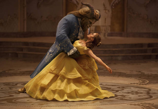 """FILE - This file image released by Disney shows Dan Stevens as The Beast, left, and Emma Watson as Belle in a live-action adaptation of the animated classic """"Beauty and the Beast."""" On the last day of the calendar year, """"Star Wars: The Last Jedi"""" has surpassed """"Beauty and the Beast"""" as the top grossing film in North America in 2017.  (Disney via AP, File)"""