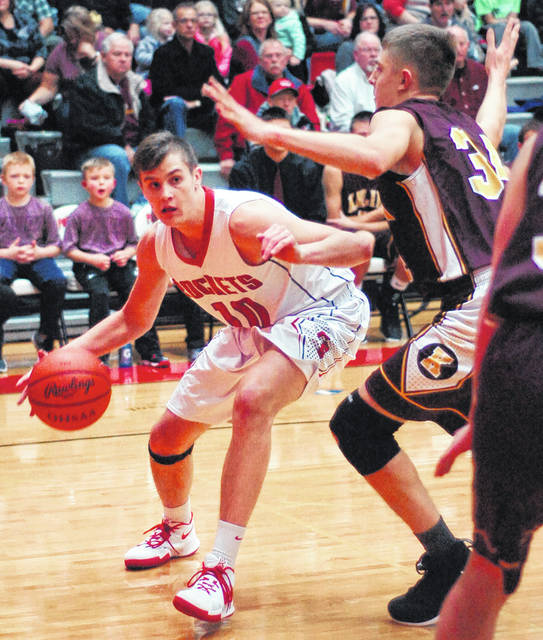 Pandora-Gilboa's Drew Johnson works his way to the basket Tuesday night against Kalida's Grant Laudick in the first half at Pandora-Gilboa High School in Pandora.