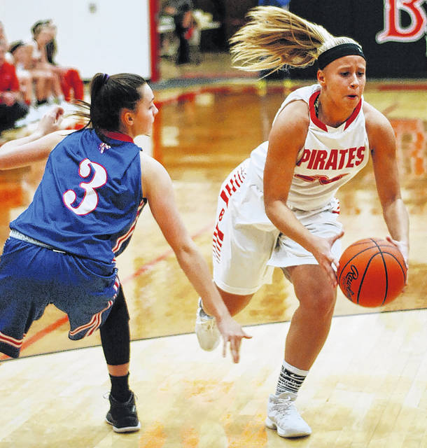 Bluffton's Alivia Koenig drives to the basket against Crestview's Bailey Gregory during Thursday night's game in Bluffton.