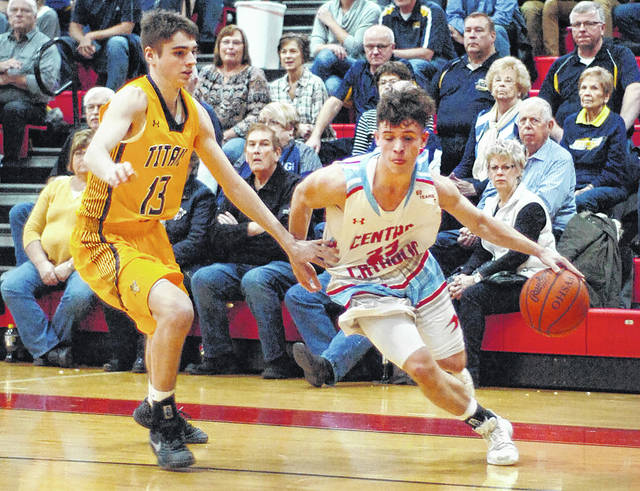 Lima Central Catholic's Matthew Cecala drives to the basket Saturday night against Ottawa-Glandorf's Carter Heringhaus during Saturday night's game at LCC.