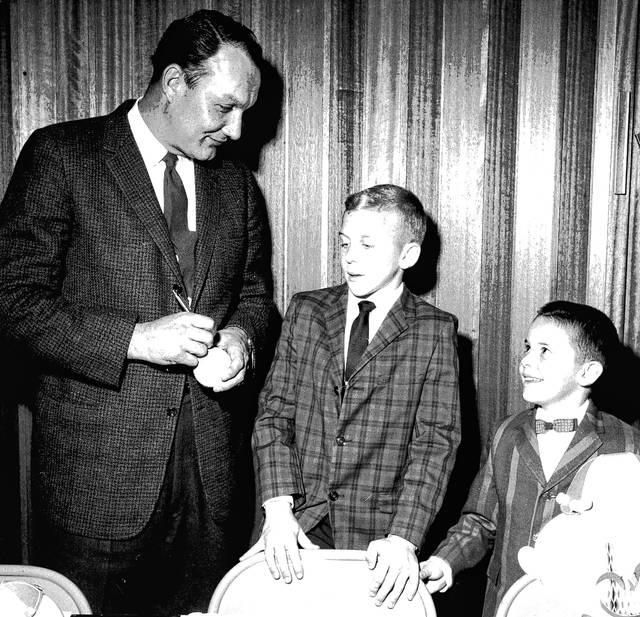 Wally Post signs a ball, pictured with Scott and Dean Montgomery in 1962. Post had spoken at a father and son banquet at Shawnee Methodist Church when this photo was taken and published in the Lima Citizen. The Montgomery boys were the sons of Richard and Connie Montgomery.