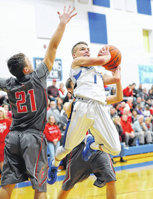 Allen East's Bradden Crumrine puts up a shot against Pandora-Gilboa's Ryan Lee during Wednesday night's game at Allen East High School. P-G won the game 68-31. No other information was reported about the game at deadline.