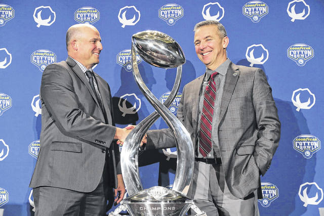 <article class=&quot;ng-binding&quot;> Southern California coach Clay Helton, left, and Ohio State coach Urban Meyer shake hands and pose for photos after a news conference for the Cotton Bowl on Thursday. </article>
