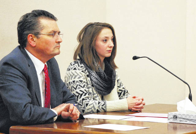 J Swygart   The Lima News  Flanked by her attorney, Patrick Mulligan, Abigail Lee listens as Judge David Cheney goes over the terms of a negotiated plea agreement that called for Lee to plead guilty to obstructing justice for taking part in the armed robbery of a Lima pharmacy in April.