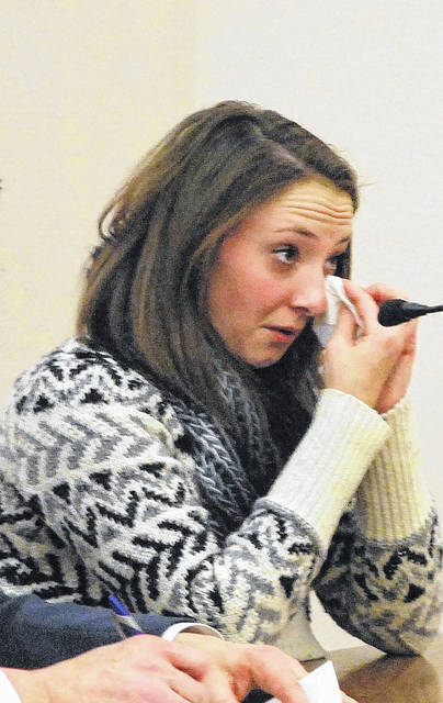 Abigail Lee, 26, of Indianapolis, fought back tears during her appearance Wednesday in Allen County Common Pleas Court. Lee pleaded guilty to obstructing justice for her role in the armed robbery of a Lima Walgreens pharmacy earlier this year.