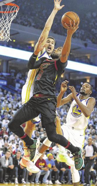 771b37cdc7e Cleveland Cavaliers guard Dwyane Wade (9) drives to the basket against  Golden State Warriors